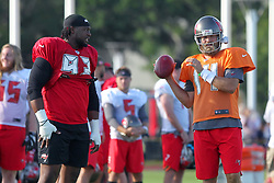 July 28, 2018 - Tampa, FL, U.S. - TAMPA, FL - JULY 28: Gerald McCoy (93) talks with Ryan Fitzpatrick (14) during the Tampa Bay Buccaneers Training Camp on July 28, 2018 at One Buccaneer Place in Tampa, Florida. (Photo by Cliff Welch/Icon Sportswire) (Credit Image: © Cliff Welch/Icon SMI via ZUMA Press)