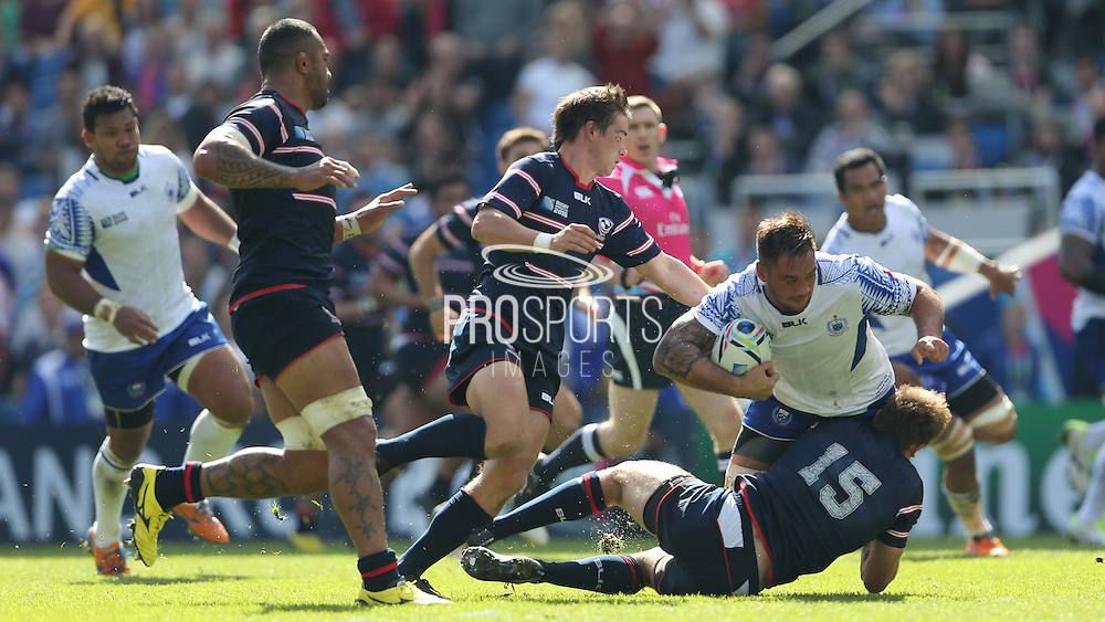 Samoa Jack Lam tackled during the Rugby World Cup 2015 match between Samoa and USA at the Brighton Community Stadium, Falmer, United Kingdom on 20 September 2015.