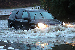 © Licensed to London News Pictures. 22/11/2016. Rotherham, UK. A driver bravely drives through a flooded road in Rotherham, South Yorkshire, after a river broke it's banks last night. Storm Angus has brought heavy wind and rain to much of the UK this week with flooding seen all over. Photo credit : Ian Hinchliffe/LNP