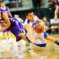 031313  Adron Gardner/Independent<br /> <br /> Laguna Acoma Hawk Anthony Carpio (21) grabs a loose ball while off balance during the 2A New Mexico High School Basketball tournament quarterfinals at Santa Ana Star Center in Rio Rancho Wednesday.
