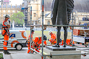 Workers put up a protective screen around the statue of Mahatma Gandhi in Parliament Square ahead of expected rival demonstrations by anti-racism and far-right protesters in London, Friday, June 12, 2020. Monuments have become major focuses of contention in demonstrations against racism and police violence. Anger against systemic levels of institutional racism has raged through the city, and worldwide; sparked following the death of George Floyd in the United States on May 25, 2020. (Photo/ Vudi Xhymshiti)