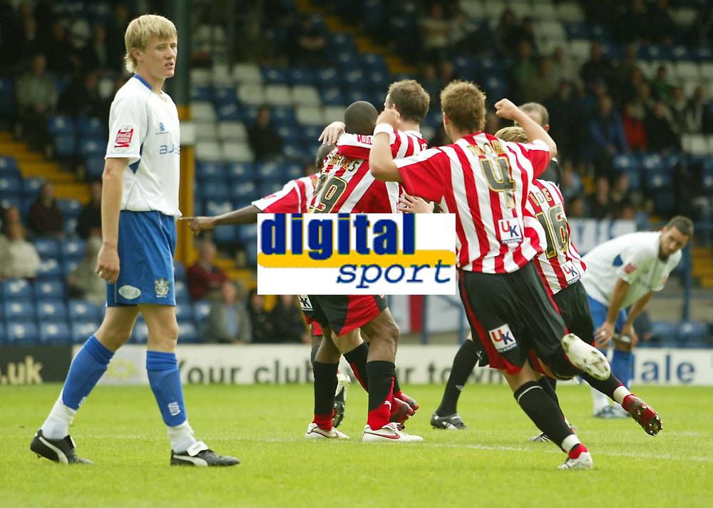Photo: Aidan Ellis.<br /> Bury FC v Brentford. Coca Cola League 2. 01/09/2007.<br /> Brentford players mob match winner Ricky Shakes after he scored the winning goal