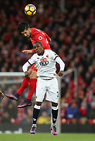 Football - 2016 / 2017 Premier League - Liverpool vs. Watford<br /> <br /> Emre Can of Liverpool out jumps Miguel Britos of Watford  during the match at Anfield<br /> <br /> COLORSPORT/LYNNE CAMERON