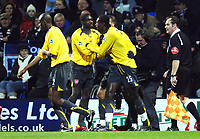 Photo: Paul Greenwood.<br />Bolton Wanderers v Arsenal. The FA Cup. 14/02/2007. Aresnal's Emmanuel Adebayor, right, is congartulated by team mate Abou Diaby, centre.