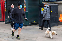 © Licensed to London News Pictures. 10/04/2021. London, UK. British Prime Minister BORIS JOHNSON is seen out on a morning run in central London with dog DILYN. Photo credit: London News Pictures