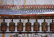 Ornately carved Buddhist prayer wheels at Swayambhunath Stupa  Buddhist monument in Nepal.