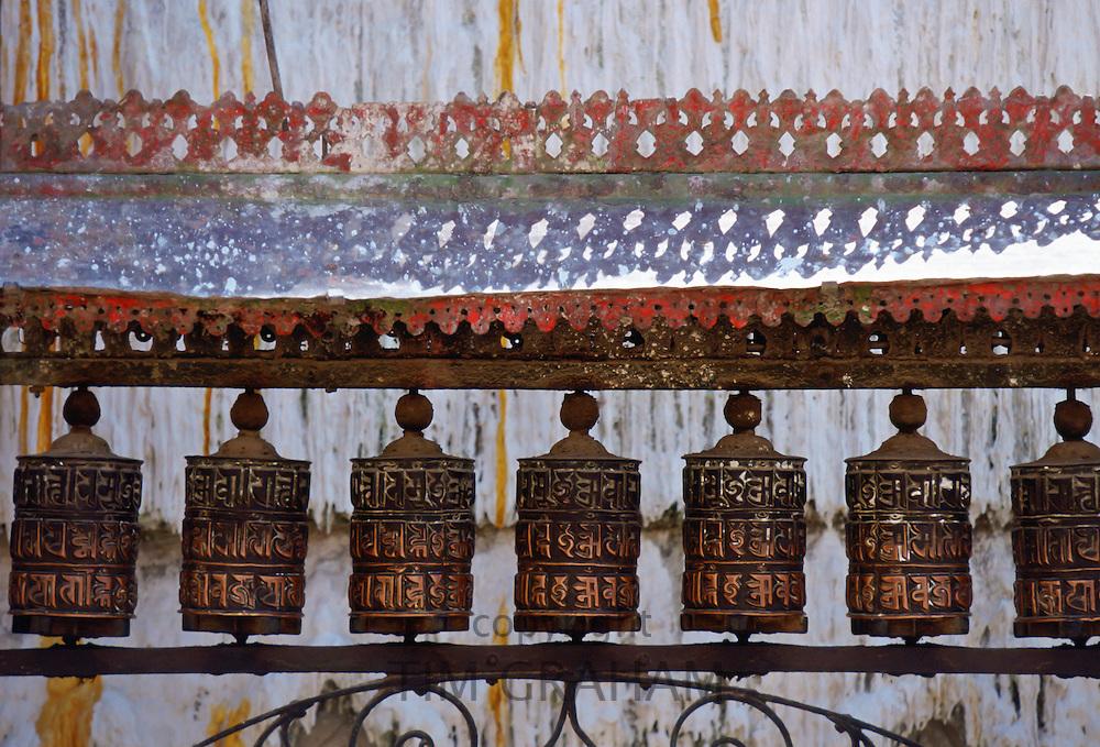 Ornately carved Buddhist prayer wheels at Swayambhunath Stupa  Buddhist monument in Nepal.