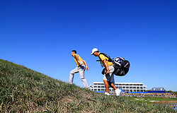 Team Europe's Rory McIlroy walk to the 15th tee with his caddie during preview day four of the Ryder Cup at Le Golf National, Saint-Quentin-en-Yvelines, Paris. PRESS ASSOCIATION Photo. Picture date: Thursday September 27, 2018. See PA story GOLF Ryder. Photo credit should read: Gareth Fuller/PA Wire. RESTRICTIONS: Editorial use only. No commercial use.