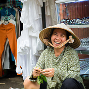 Woman preparing vegetables at street market in Saigon