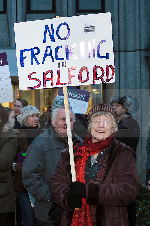 © Licensed to London News Pictures. 15/01/2014. Salford, UK An Anti fracking demonstration held at Salford Civic Centre during a Salford council meeting. The energy company IGas has been granted permission to build a vertical test well at the site in Barton Moss, between Barton Aerodrome and the M62 motorwayPhoto credit : Steve Purcell/LNP