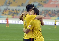 Elkeson of Guangzhou Evergrande, right, hugs teammate Gao Lin to celebrate after scoring Guangzhou's second goal against Guizhou Renhe during the 28th round of the 2014 Chinese Football Association Super League in Guiyang city, southwest China's Guizhou province, 18 October 2014.<br /> <br /> Guangzhou Evergrande defeated Guizhou Renhe 2-1.