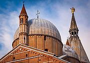 "The Pontifical Basilica of Saint Anthony of Padua (Italian: Basilica Pontificia di Sant'Antonio di Padova) is a Roman Catholic church and minor basilica in Padua, northern Italy. Although the Basilica is visited as a place of pilgrimage by people from all over the world, it is not the titular cathedral of the city, a title belonging to the Cathedral-Basilica of St. Mary of Padua. The basilica is known locally as ""il Santo""."