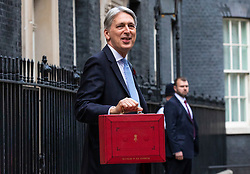 © Licensed to London News Pictures. 29/10/2018. London, UK. The Chancellor of The Exchequer Philip Hammond (centre) with the red dispatch box stands with Treasury staff as he leaves 11 Downing Street before delivering the budget in Parliament. Photo credit: Rob Pinney/LNP