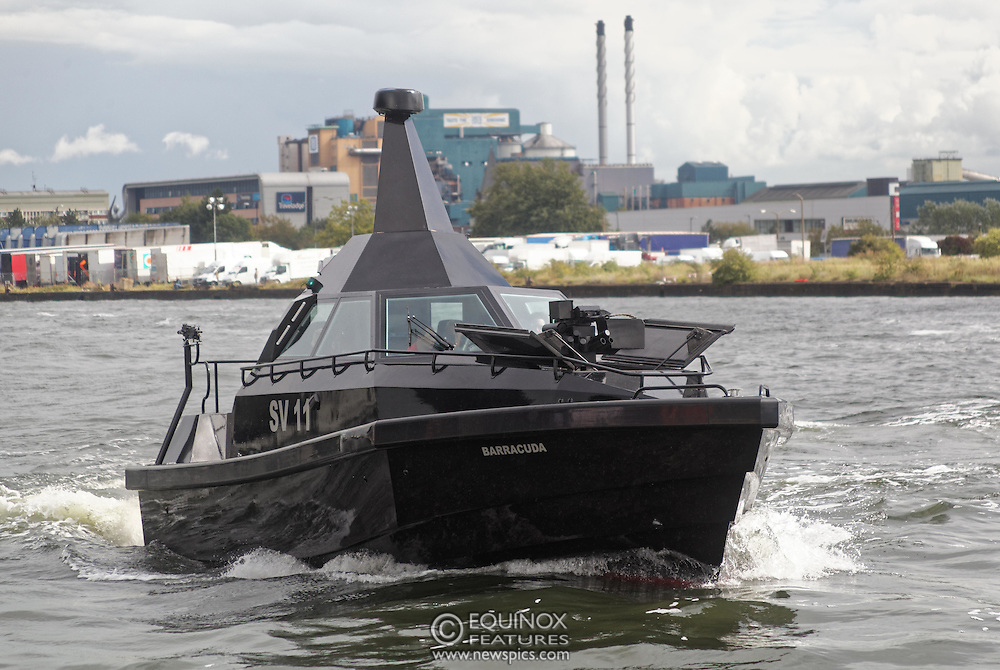 London, United Kingdom - 18 September 2015<br /> Safehaven Marine demonstrate their SV11 Barracuda stealth boat with front mounted retractable gun and radar avoidance technology at Operation MARICAP waterborne demonstration at the defence and security exhibition DSEI at ExCeL, Woolwich, London, England, UK.<br /> (photo by: EQUINOXFEATURES.COM)<br /> <br /> Picture Data:<br /> Photographer: Equinox Features<br /> Copyright: ©2015 Equinox Licensing Ltd. +448700 780000<br /> Contact: Equinox Features<br /> Date Taken: 20150918<br /> Time Taken: 14344443<br /> www.newspics.com