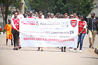 "U.K. soccer club Arsenal and the Rwandan Development Board announced a sponsorship deal in late May 2018 which will see ""Visit Rwanda"" printed on the sleeves of the Arsenal kit for the next 3 seasons at a cost to the Rwanda Development board of £10million per season. It is  intended to promote tourism to Rwanda. Pictured here Rwanda Arsenal supporters march to remember genocide victims in Kigali May 28th, 2018"