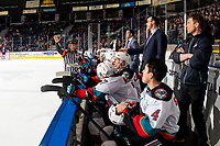 KELOWNA, BC - MARCH 7: Referee Chris Crich stands at the bench of the Kelowna Rockets speaking to head coach Kris Mallette during second period against the Lethbridge Hurricanes at Prospera Place on March 7, 2020 in Kelowna, Canada. (Photo by Marissa Baecker/Shoot the Breeze)