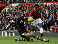 Photo: Paul Thomas.<br /> Manchester United v Charlton Athletic. The Barclays Premiership. 10/02/2007.<br /> <br /> Patrice Evra of Man Utd crosses in front of Madjid Bougherra.