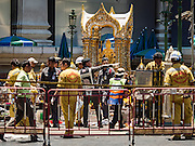 18 AUGUST 2015 - BANGKOK, THAILAND: Thai soldiers, police and volunteer paramedics at Erawan Shrine Tuesday morning. An explosion at Erawan Shrine, a popular tourist attraction and important religious shrine in the heart of the Bangkok shopping district killed at least 20 people and injured more than 120 others, including foreign tourists, during the Monday evening rush hour. Twelve of the dead were killed at the scene. Thai police said an Improvised Explosive Device (IED) was detonated at 18.55. Police said the bomb was made of more than six pounds of explosives stuffed in a pipe and wrapped with white cloth. Its destructive radius was estimated at 100 meters.     PHOTO BY JACK KURTZ