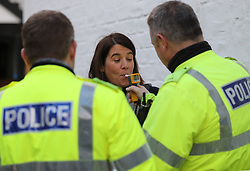 A woman is breathalysed by officers from Police Scotland as they  launch their annual festive drink-drive campaign in Glasgow. PRESS ASSOCIATION Photo. Picture date: Thursday December 1, 2016. See PA story SCOTLAND Alcohol. Photo credit should read: Andrew Milligan/PA Wire<br />