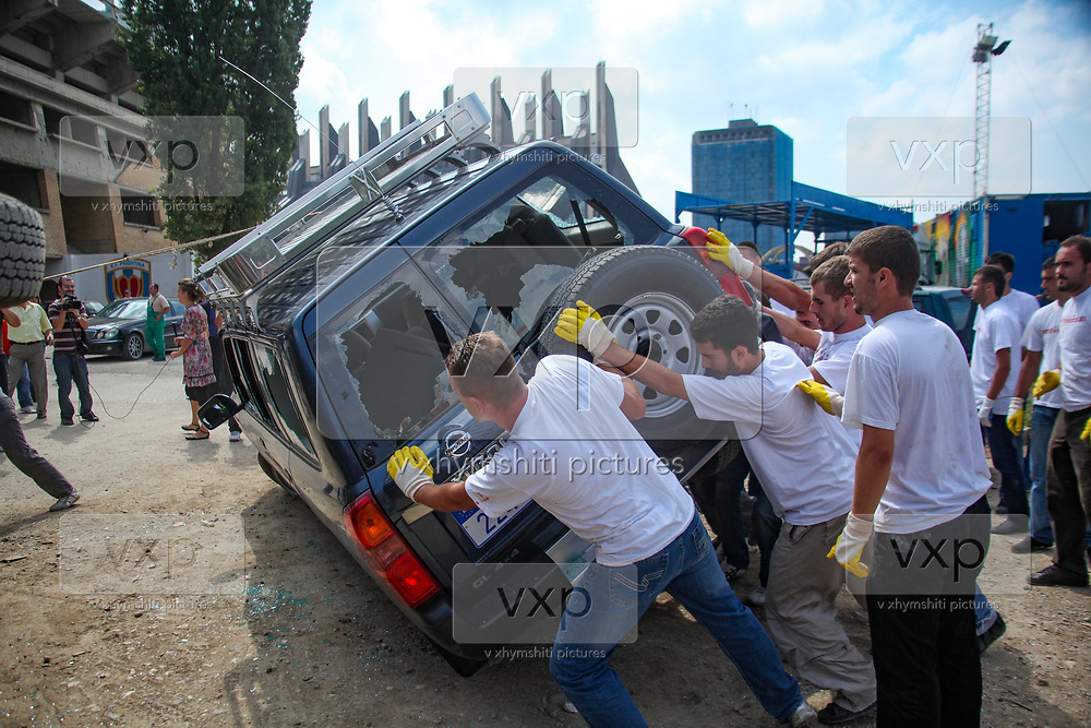 """Activists of the youth movement """"VETEVENDOSJE"""" meaning Self-determination, overthrown Eulex (European Mission Rule of Law in Kosovo) car in protest at negotiations with Serbia on the province's future, August 25, 2009. (Photo/Vudi Xhymshiti)"""