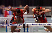 Duane Ross (left) and Ron Bramlett compete in the 60-meter hurdle semifinals in the USA Track & Field Indoor Championships at the Reggie Lewis Track & Athletic Center at Roxbury Community College on Saturday, Feb. 28, 2004 in Roxbury Crossing, Mass.