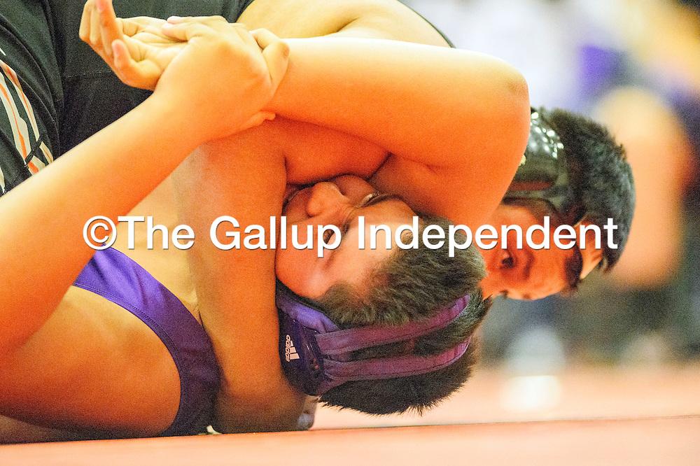 012815  Adron Gardner/Independent<br /> <br /> Gallup Bengal Dade Begay attempts to pin Miyamura Patriot Raphael Sanchez at Miyamura High School in Gallup Wednesday.