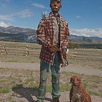 A whimsical welded sculpture by renowned Montana artist Jim Dolan stands in a roadside pullout near Upper Holter Lake, Montana.