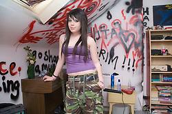 Teenaged girl in her bedroom,