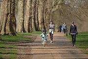 People are seen doing exercise in Hyde Park, central London on Sunday, March 14, 2021. Many people appear to defy coronavirus restriction guidelines to wear a face mask whilst sharing a space with other members of the public. Coronavirus has hit the UK hard, with the country recording more than 3m cases and 125,000 deaths linked to the disease. (VXP Photo/ Vudi Xhymshiti)