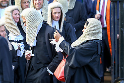 © Licensed to London News Pictures. 01/10/2019. London, UK. A Judge takes a selfie as the Judges, QCs and senior legal figures leave Westminster Abbey for The Houses of Parliament after attending the annual service to mark the start of the legal year. The start of the new legal year is marked with a traditional religious service in Westminster Abbey followed by a procession to The Houses of Parliament where the Lord Chancellor (Justice Secretary) hosts a reception.   Photo credit: Dinendra Haria/LNP