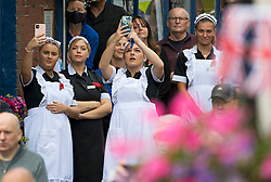 © Licensed to London News Pictures. 10/07/2020. London, UK. Members of the public gather in the town of Ditchling, East Sussex, to pay their respects ahead of the funeral of Dame Vera Lynn. The 'Forces' Sweetheart', who died last month aged 103, was famous for singing performances during WW2, which helped raise morale amongst troops abroad. Photo credit: Ben Cawthra/LNP