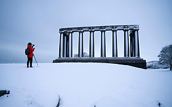 Edinburgh, Scotland, UK. 21 January 2020. Storm Christoph brought overnight snow to Edinburgh. Pic; View of a snow covered Calton Hill. Iain Masterton/Alamy Live News