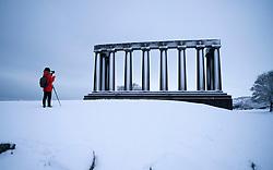 Edinburgh, Scotland, UK. 21 January 2020. Storm Christoph brought overnight snow to Edinburgh. Pic; View of a snow covered Calton Hill. Iain Masterton/Alamy Live News