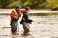 Guide, Warren Coleman teaching a young man to fly fish on the upper Connecticut River, Vermont.