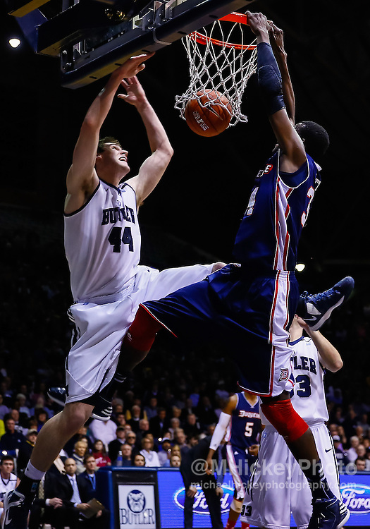 INDIANAPOLIS, IN - FEBRUARY 19: As Andrew Smith #44 of the Butler Bulldogs defends Mamadou Datt #34 of the Duquesne Dukes dunks the ball at Hinkle Fieldhouse on February 19, 2013 in Indianapolis, Indiana. (Photo by Michael Hickey/Getty Images) *** Local Caption *** Andrew Smith; Mamadou Datt