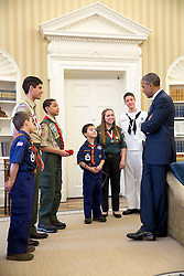 President Barack Obama greets representatives from the Boy Scouts of America to receive their Report to the Nation March 25, 2015. (Official White House Photo by Pete Souza)<br /> <br /> This official White House photograph is being made available only for publication by news organizations and/or for personal use printing by the subject(s) of the photograph. The photograph may not be manipulated in any way and may not be used in commercial or political materials, advertisements, emails, products, promotions that in any way suggests approval or endorsement of the President, the First Family, or the White House.