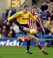 Photo: Richard Lane.<br /> Oxford United v Lincoln City. Nationwide Division Three. 10/01/2004.<br /> Steve Basham takes the ball as Ben Fulcher moves in.