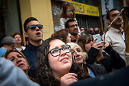 People gathering along the streets to watch, admire and pray at the passage of the processions during the Holy Week. Seville, Spain