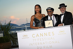 71st Cannes Film Festival Prizes Photocall. US director Spike Lee poses with his trophy on May 19, 2018 next to US actress Laura Harrier and a guest during a photocall after he won the Grand Prix for the film BlacKkKlansman at the 71st edition of the Cannes Film Festival. Photo by Shootpix/ABACAPRESS.COM