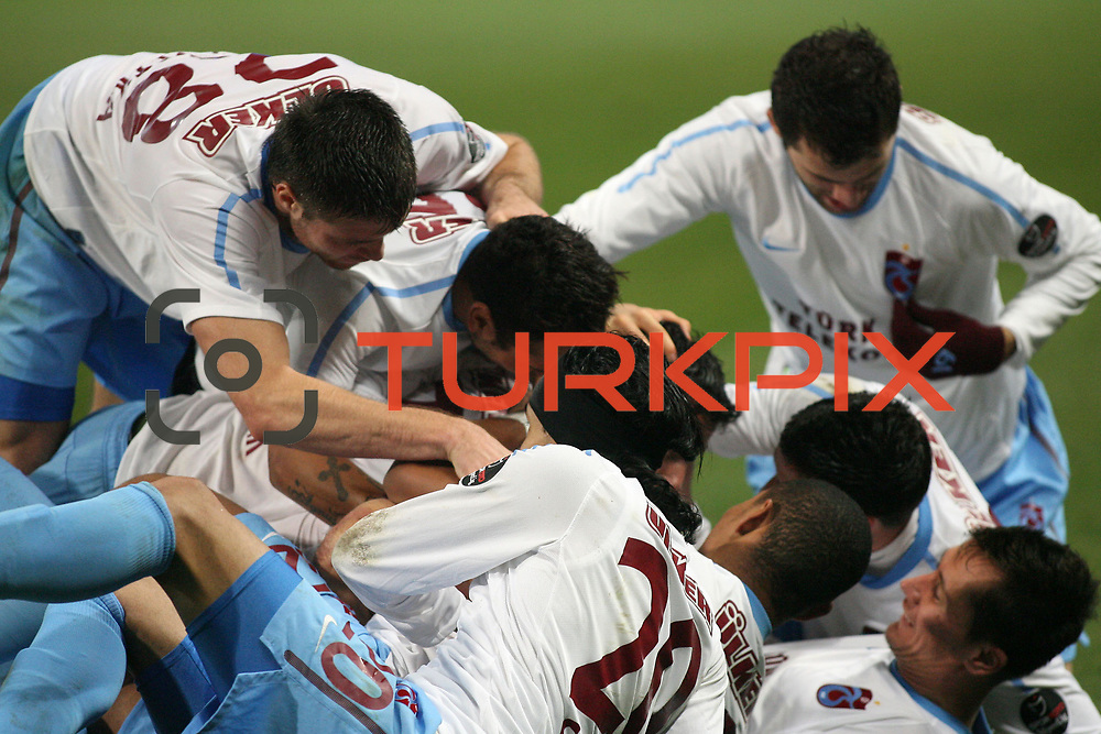 Trabzonspor's Burak Yilmaz celebrate his goal with team mate during their Turkish soccer superleague match IBBSpor between Trabzonspor at the Ataturk Olympic stadium in Istanbul Turkey on Saturday 07 January 2012. Photo by TURKPIX