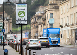 © Licensed to London News Pictures; 18/03/2021; Bath, UK. Traffic on the London Road enters the Bath Clean Air Zone (CAZ) which has started operation this week, the first CAZ in the UK outside London. Several other cities are set to introduce CAZs in the next year. Older buses, taxis and commercial vehicles are now being charged between £9 and £100 per day to enter the Bath CAZ if they are not compliant with low exhaust emission standards, but private cars are not being charged in Bath. BANES Council says Bath's CAZ will help the city meet UK air quality legislation. Several places in Bath currently exceed the legal limits for nitrogen dioxide (NO2) pollution which is mainly caused by vehicle emissions, and that poor air quality plays in damaging people's health. Photo credit: Simon Chapman/LNP.