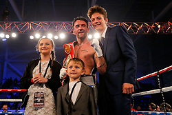 Lee Haskins (blue/white shorts) celebrates with his family after he defeats Ivan Morales (black/white shorts) by unanimous decision to keep the IBF World Bantamweight Title - Mandatory byline: Rogan Thomson/JMP - 14/05/2016 - BOXING - Ice Arena Wales - Cardiff, Wales - Lee Haskins v Ivan Morales - IBF World Bantamweight Title.
