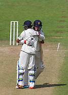Jeetan Patel(5) and Tom Milnes (Warwickshire County Cricket Club) celebrate after winning the LV County Championship Div 1 match between Durham County Cricket Club and Warwickshire County Cricket Club at the Emirates Durham ICG Ground, Chester-le-Street, United Kingdom on 15 July 2015. Photo by George Ledger.