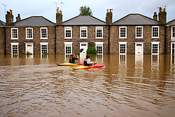 File photo dated 26/06/07 of canoeists taking advantage of the floods in Beverley, East Yorkshire. The 2007 floods which brought devastation to Sheffield and Hull and left three people dead are being remembered 10 years after the deluge.