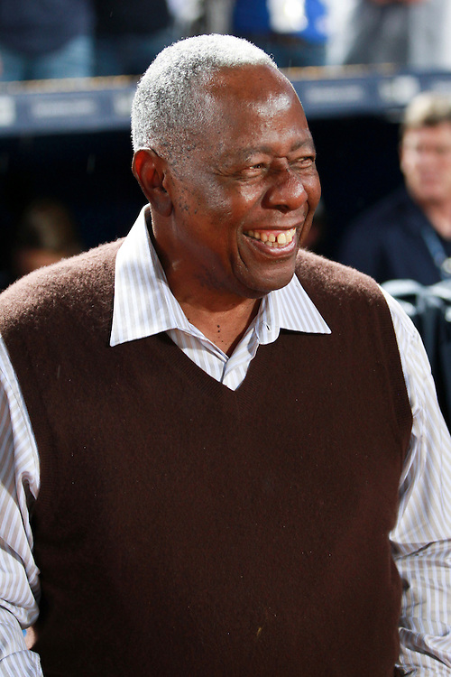Former Atlanta Braves great Hank Aaron smiles during a pre-game ceremony before the home opener against the New York Mets, Friday, April 10, 2015, in Atlanta. The Braves won 5-3. (AP Photo/Kevin Liles)