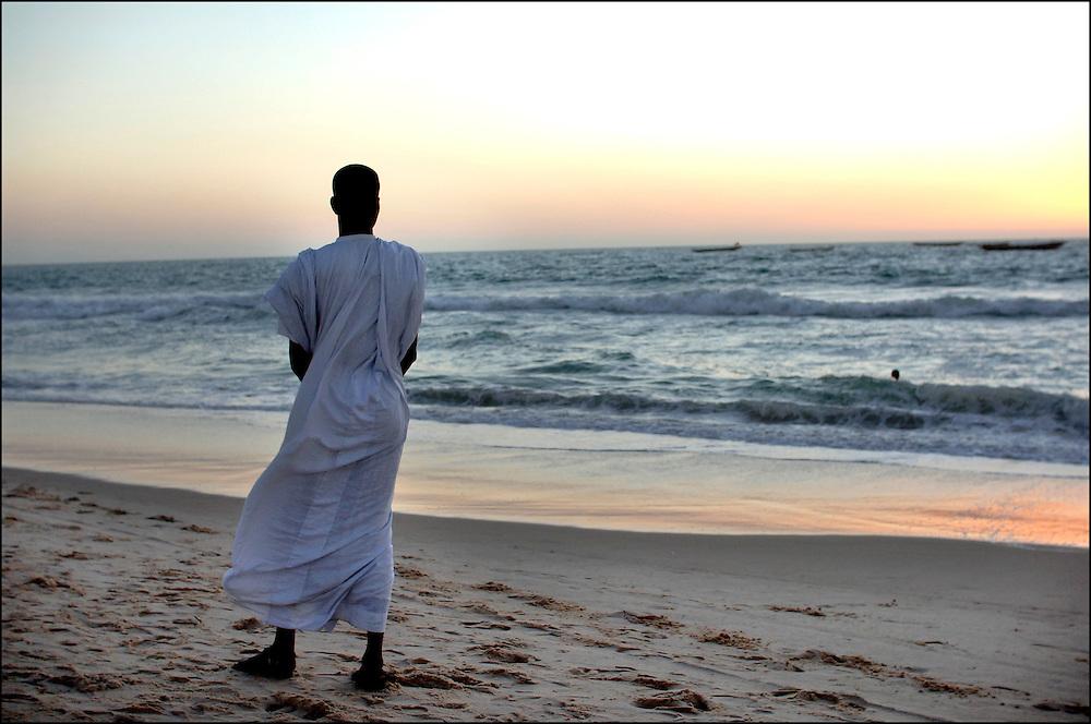 Mauritania October 27, 2006 - Man taking a walk along a beach in Nouakchott. ©Jean-Michel Clajot