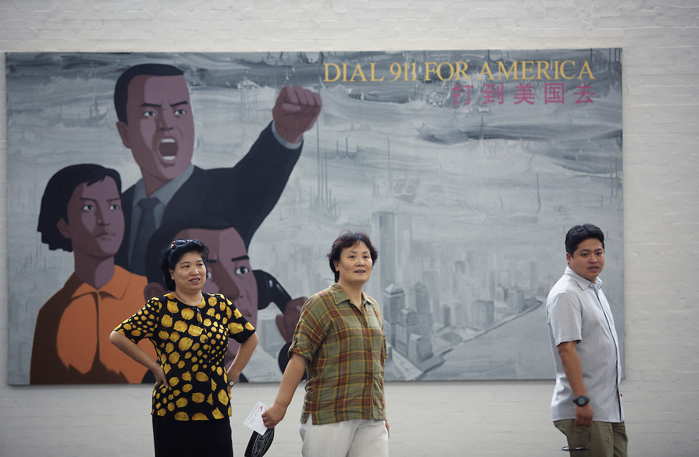 Visitos look at modern art in Gallery 798 in Dashanzi. China's art scene is becoming popular among foreign art collectors pushing prices higher.