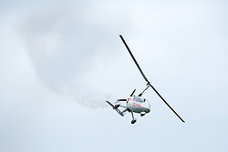 © Licensed to London News Pictures.  02/06/2017; Torbay, Devon, UK. Torbay Airshow 2017. Press call for Launch of the 2017 Torbay Airshow. An Autogyro performs a display over Tor Bay ahead of the 2017 Torbay Airshow. The Autogyro flying display, also known as a Gyrocopter or Gyroplane, is described as a flying windmill or a rotating parachute which looks like a sycamore seed gently floating down as it spins. The 2017 Torbay Airshow is set to return this weekend on Saturday 3 and Sunday 4 June with an action packed programme of world class air displays. The world's premier aerobatic team The Red Arrows will be debuting a new routine in the first display of their season, featuring their trademark combination of close formations and precision flying. The full display programme for the weekend begins on the Saturday between 2-3pm with The Tigers Freefall Parachute Display Team, Team Raven Aerobatic Display Team, the Percival Piston Provost and the Strikemaster. From 3-4pm will be the highly anticipated display by the Red Arrows, former British Female Aerobatic Champion Lauren Richardson in her Pitts Special S1-S and world aerobatic competitor Gerald Cooper in his Xtreme XA41. Finishing off the action packed afternoon from 4-5pm will see displays from the AutoGyro, the Battle of Britain Memorial Flight aircraft, the PBY5A Catalina seaplane, The Blades and the Royal Air Force's Typhoon FGR4. Sunday afternoon will see each of the aircraft take to the skies again before the weekend closes with a final display from the RAF Chinook team. The two day show, which had its inaugural event last year, takes place on Paignton Green with the Bay providing a stunning natural amphitheatre for viewing the air displays and the perfect location for a large coastal airshow event. To stay up to date with the latest Torbay Airshow news and updates follow @torbayairshow on Facebook, Twitter and Instagram or visit www.torbayairshow.com. Picture credit : Simon Chapman/LNP