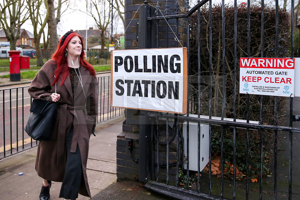 © Licensed to London News Pictures. 12/12/2019. London, UK. A voter arrives at a polling station in Haringey, north London to vote in the UK General Election. Polling stations have opened as the nation votes to decide the next UK Government in the first December election since 1923. Photo credit: Dinendra Haria/LNP