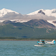 A float plane taking off from the water. These planes are used to take tourists to see the brown bears in Katmai National Park, Alaska.